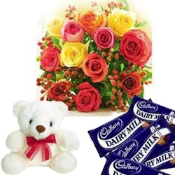 Bouquet of roses, teddy and chocolates in a present